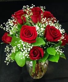 Red rose special  arrangement in a beautiful clear vase.