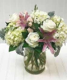 Hydrangea, Roses, Lilies in a glass hurricane