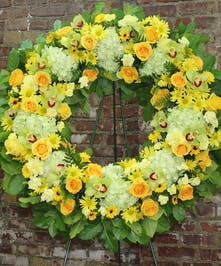 This ray of light wreath brings warm memories to any funeral.