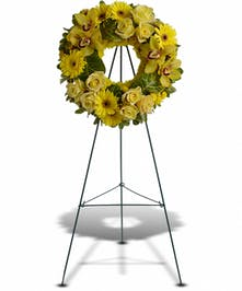 This sunny wreath brings warm memories to any funeral.