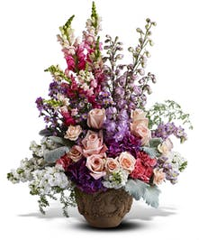A garden medley of pastel blooms for any occasion.