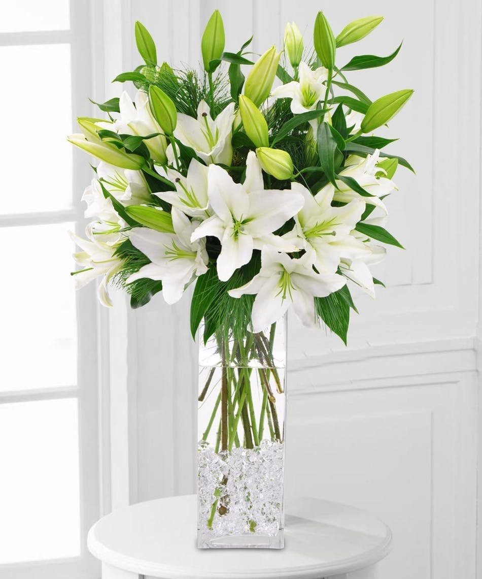 Winter White Lilies Tall Vase Of White Lilies Products By Blossom