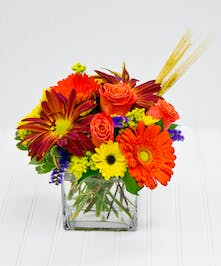 Roses, daisies, crysanthamums - orange, red - glass cube