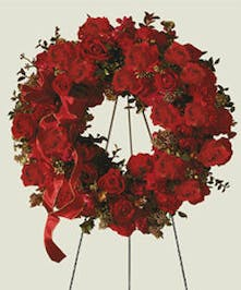A wreath with stunning red roses to show infinite love.